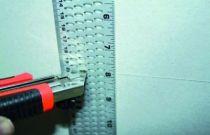 Règle à découper les plaques de plâtre